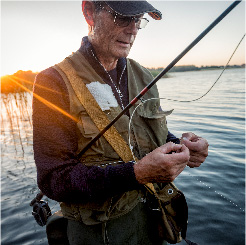 Photo of man fishing